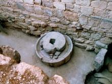 Ölmühlstein am Zeustempel